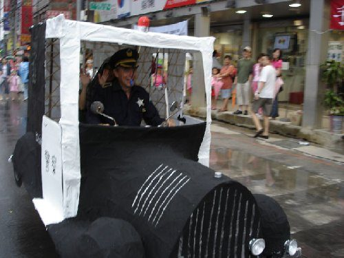 Police car made with bamboo and paper mache -Taipei Parade 2005